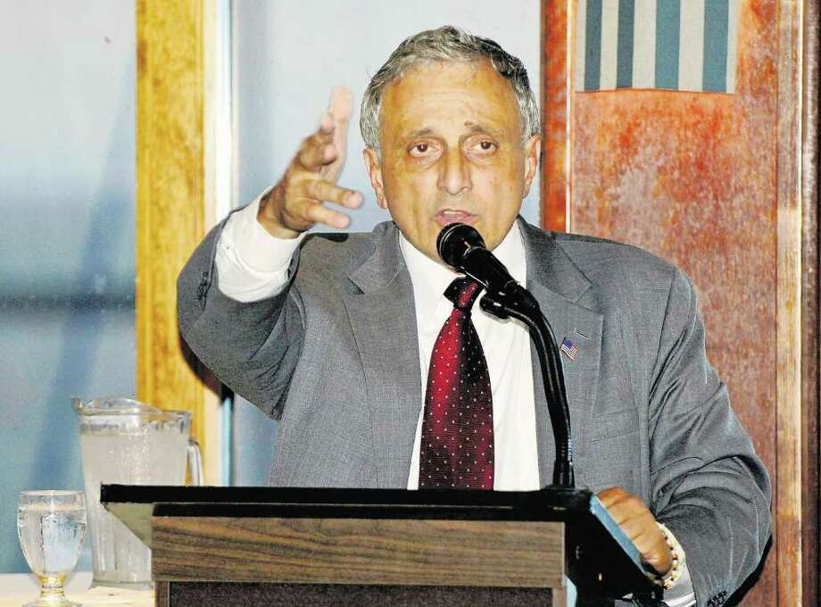 Carl Paladino, the state GOP gubernatorial candidate, gets millions from state leases.  He wants to cut costs, but a spokesman says a contract   is a contract and state leases could be renegotiated when they expire. (Don Heupel/Associated Press) Photo: Don Heupel / FR48438 AP