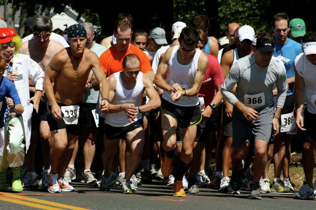 Participants in the 10k portion of Sunday's 31st annual Darien Road Race get ready while they wait for the signal to start.