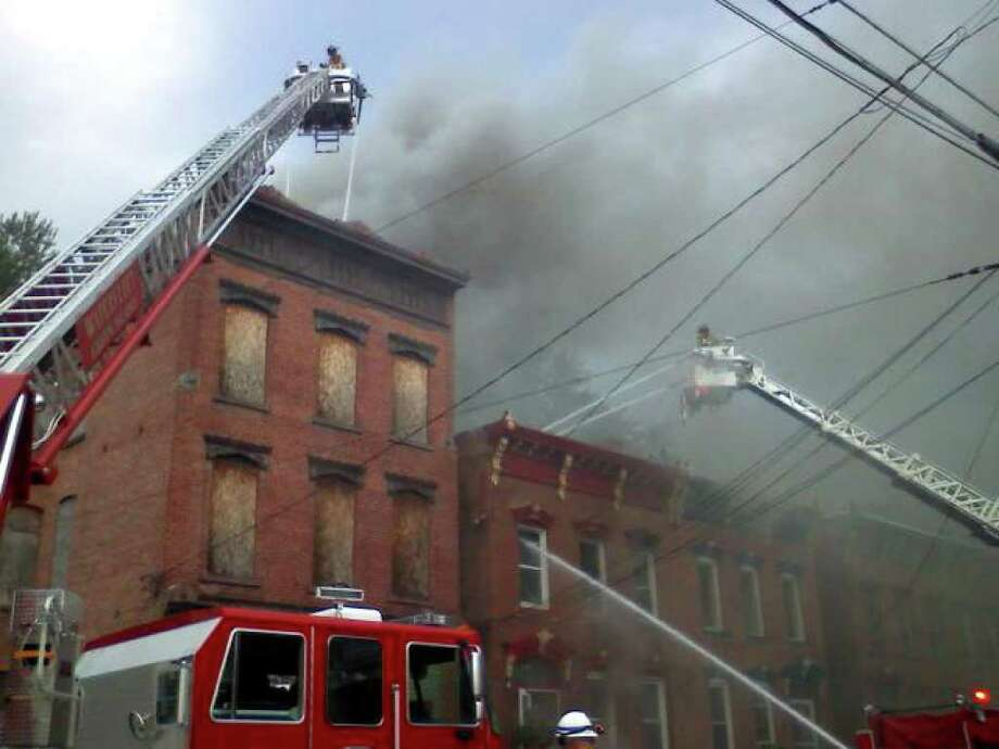Scene of the fire at 3237 Seventh Ave. in Troy Wednesday morning. (Michael P. Farrell / Times Union)