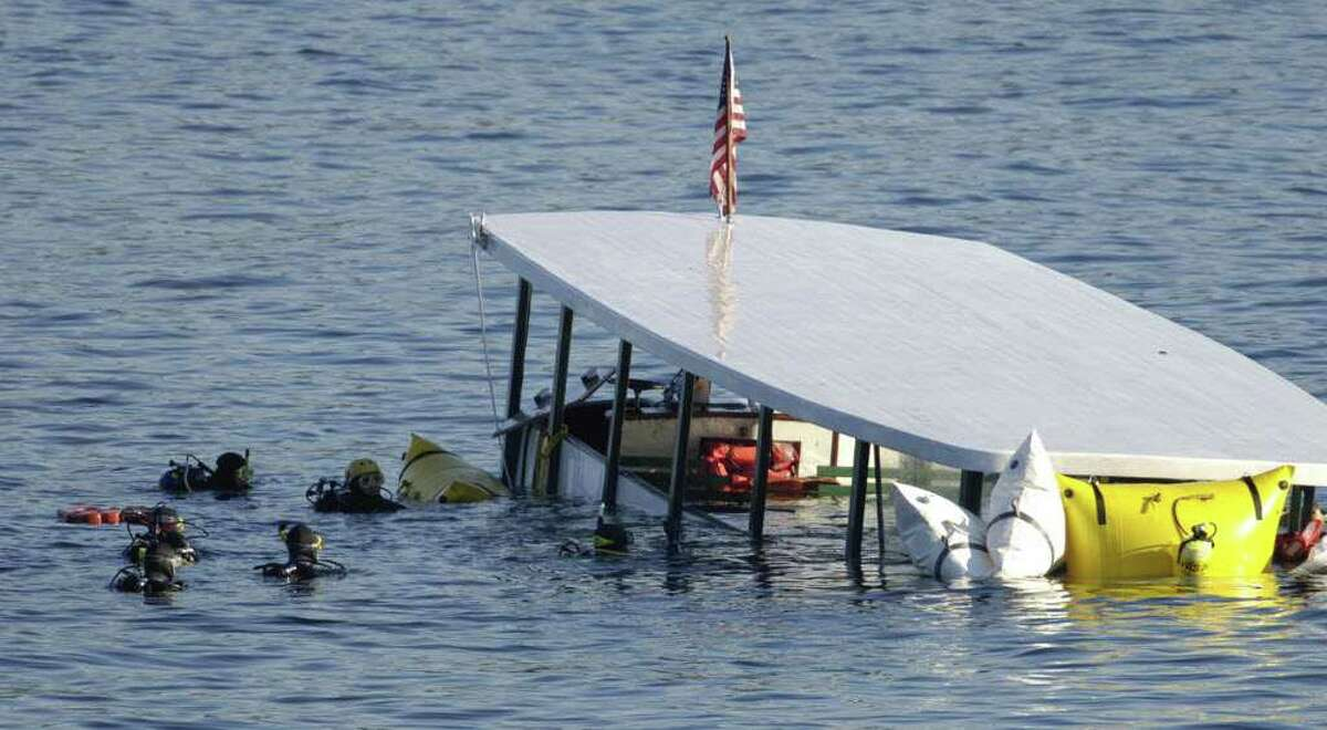 Divers wait near the partially submerged Ethan Allen on Lake George in this October 2005 photo. (Skip Dickstein/Times Union archive)