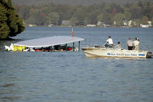 The tour boat  Ethan  Allen is brought to the surface of  Lake George in October 2005. ( Associated Press archive )