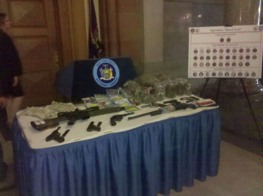 Weapons, marijuana and cash that state investigators said they seized during an investigation of the Bloods street gang in Albany (JORDAN CARLEO-EVANGELIST / TIMES UNION)