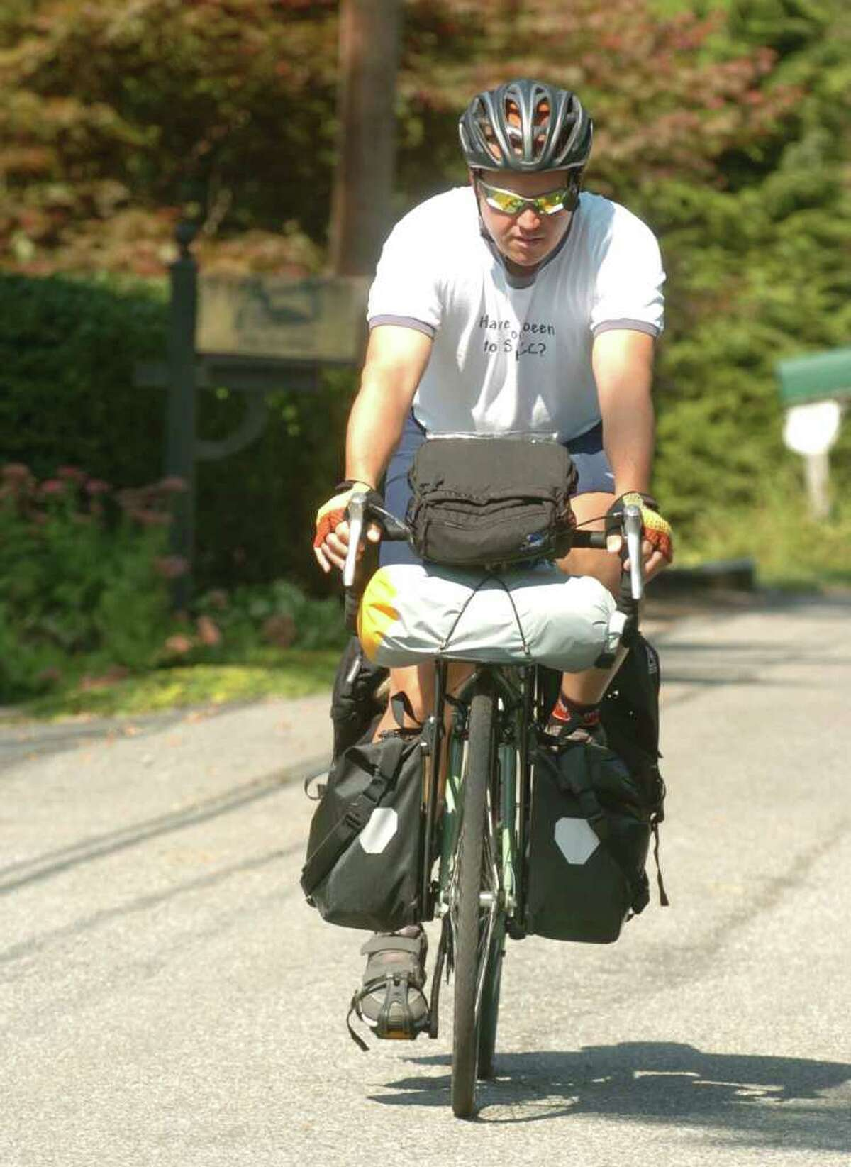 Blake Brown, 37, of Brookfield, takes a ride outside his home in Brookfield, Sept. 22, 2010. Brown is riding his bicycle from Maine to Florida on a 37-week journey to raise money for his church.
