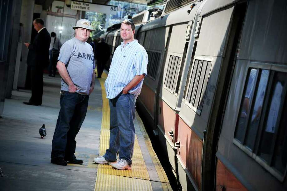 Brothers Troy Finn and Tom Finn are both are members of the U.S. Army Reserves who served in Afghanistan and Iraq and are Metro-North conductors.  They stand on the train platform at the Stamford train station in Stamford, Conn. on Wednesday September 22,  2010. Photo: Kathleen O'Rourke / Stamford Advocate