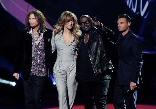 "INGLEWOOD, CA - SEPTEMBER 22:  (L-R) Singers Steven Tyler, Jennifer Lopez,  musician Randy Jackson and host Ryan Seacrest appear onstage at a press conference to officially announce the season 10 ""American Idol"" judges panel at The Forum on September 22, 2010 in Inglewood, California.  (Photo by Kevin Winter/Getty Images) *** Local Caption *** Steven Tyler;Jennifer Lopez;Randy Jackson;Ryan Seacrest Photo: Kevin Winter, Getty Images / 2010 Getty Images"