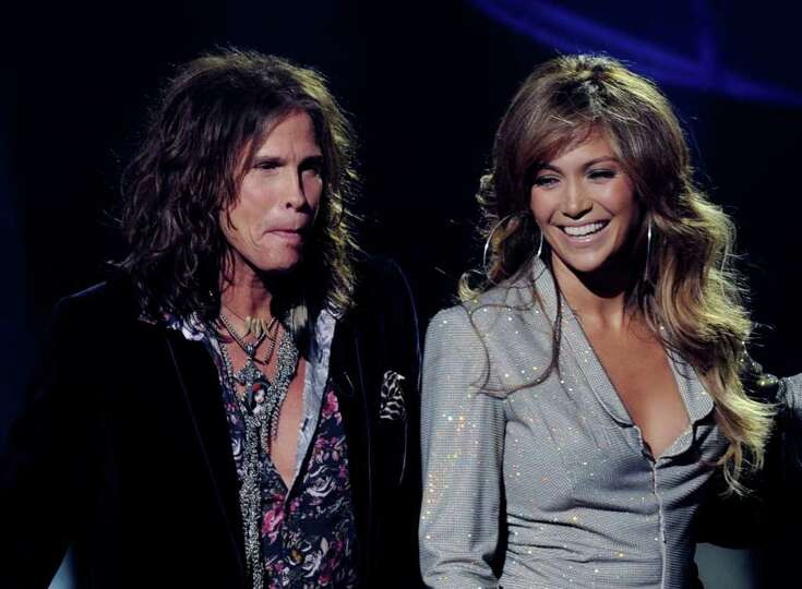 INGLEWOOD, CA - SEPTEMBER 22:  Singers Steven Tyler (L) and Jennifer Lopez appear onstage at a press