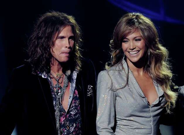 "INGLEWOOD, CA - SEPTEMBER 22:  Singers Steven Tyler (L) and Jennifer Lopez appear onstage at a press conference to officially announce the season 10 ""American Idol"" judges panel at The Forum on September 22, 2010 in Inglewood, California.  (Photo by Kevin Winter/Getty Images) *** Local Caption *** Steven Tyler;Jennifer Lopez Photo: Kevin Winter, Getty Images / 2010 Getty Images"