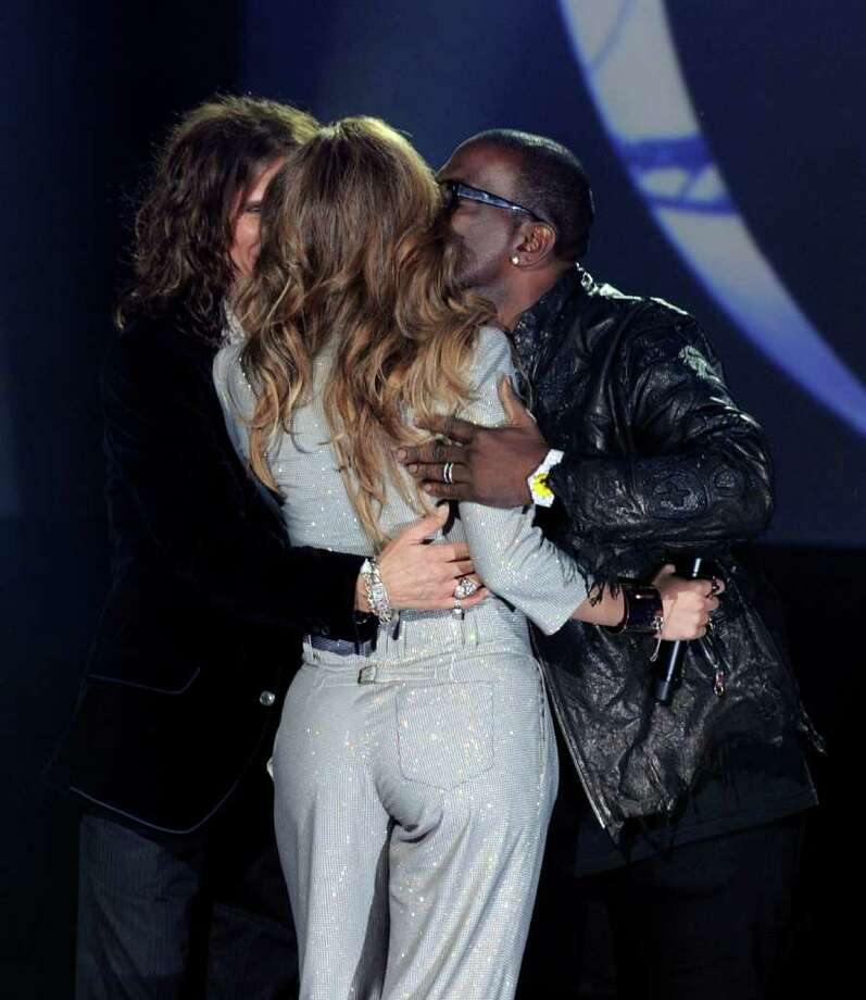 """INGLEWOOD, CA - SEPTEMBER 22:  (L-R) Singers Steven Tyler, Jennifer Lopez and musician Randy Jackson appear onstage at a press conference to officially announce the season 10 """"American Idol"""" judges panel at The Forum on September 22, 2010 in Inglewood, California.  (Photo by Kevin Winter/Getty Images) *** Local Caption *** Steven Tyler;Jennifer Lopez;Randy Jackson Photo: Kevin Winter, Getty Images / 2010 Getty Images"""