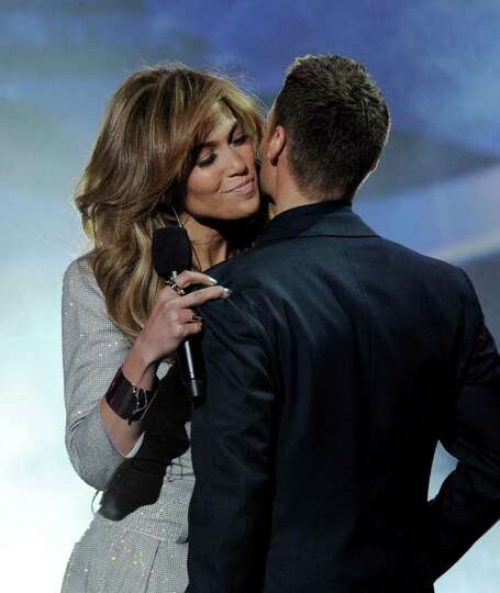 INGLEWOOD, CA - SEPTEMBER 22:  Singer Jennifer Lopez (L) and host Ryan Seacrest appear onstage at a