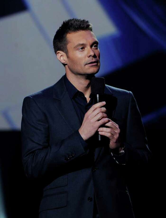 """INGLEWOOD, CA - SEPTEMBER 22:  Host Ryan Seacrest appears onstage at a press conference to officially announce the season 10 """"American Idol"""" judges panel at The Forum on September 22, 2010 in Inglewood, California.  (Photo by Kevin Winter/Getty Images) *** Local Caption *** Ryan Seacrest Photo: Kevin Winter, Getty Images / 2010 Getty Images"""