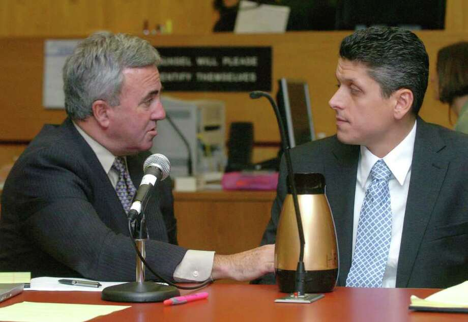 Lawyer Mickey Sherman, left, speaks to defendant Marash Gojcaj at the Superior Court in Danbury in this Sept., 15, 2010 file photo. Photo: Chris Ware / The News-Times