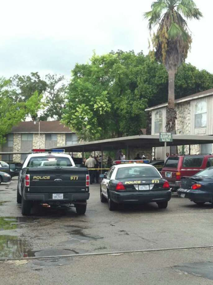 San Antonio police process a Northwest Side parking lot, where a man was fatally shot Wednesday afternoon. Photo by Eva Ruth Moravec; emoravec@express-news.net
