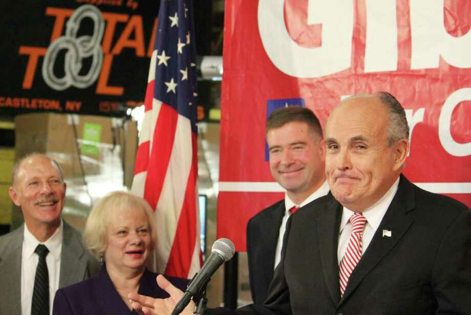 Ex-New York City Mayor Rudy Giuliani endorsed Chris Gibson, center, the GOP candidate for the 20th district at an event Wednesday at Total Tool Co. in Schodack, but he hit House Speaker Nancy Pelosi, not the incumbent.  Total president Kathy Dederick is at left. (Chelsea Kruger/Times Union) Photo: Chelsea Kruger / 00010346A