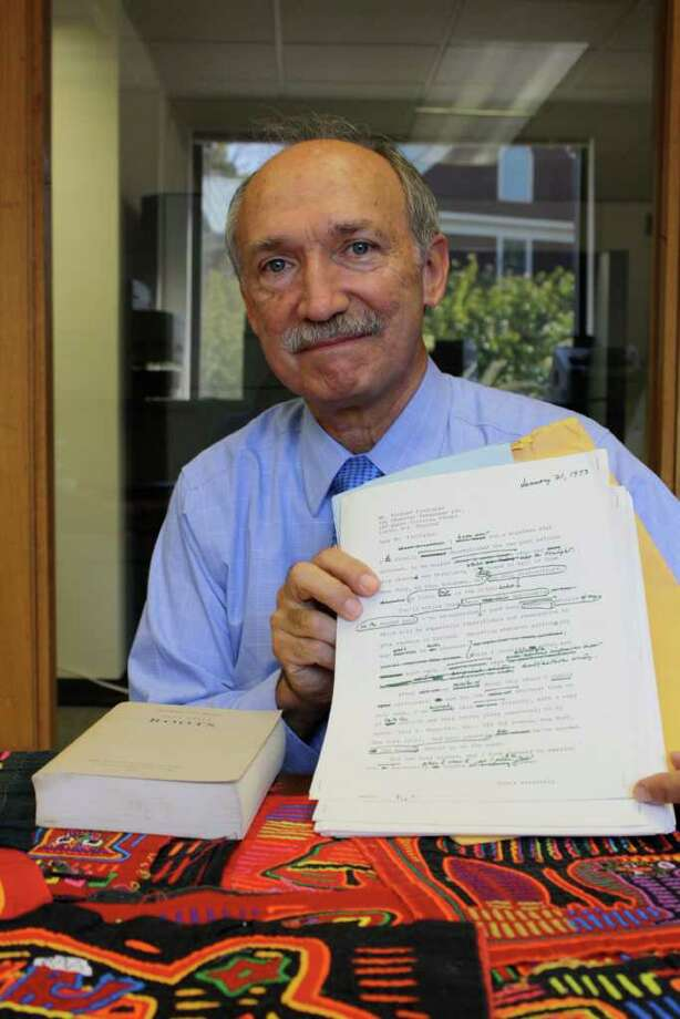 Gil Rodriguez sits with a few items from his personal collection, including 36 pages of the manuscript for Alex Haley's book, Roots. Photo: Ben Holbrook Contributed Photo, Contributed Photo / Darien News