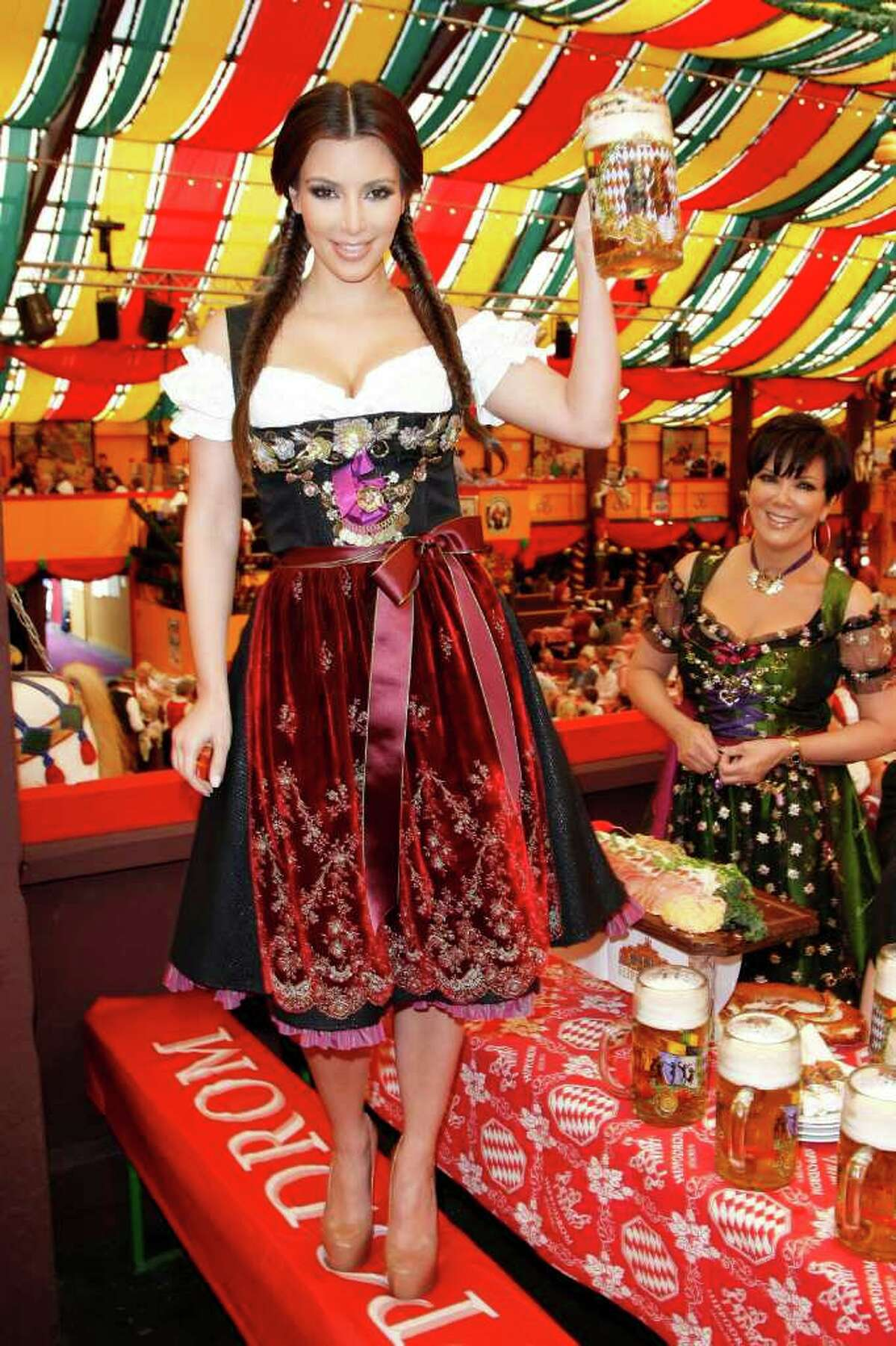 MUNICH, GERMANY - SEPTEMBER 22: Kim Kardashian (Dirndl/Dress: Lola Paltinger, Lollipop & Alenrock) visits the Oktoberfest 2010 at the Hippodrom tent at Theresienwiese during her Munich visit on September 22, 2010 in Munich, Germany. (Photo by Florian Seefried/Getty Images) *** Local Caption *** Kim Kardashian