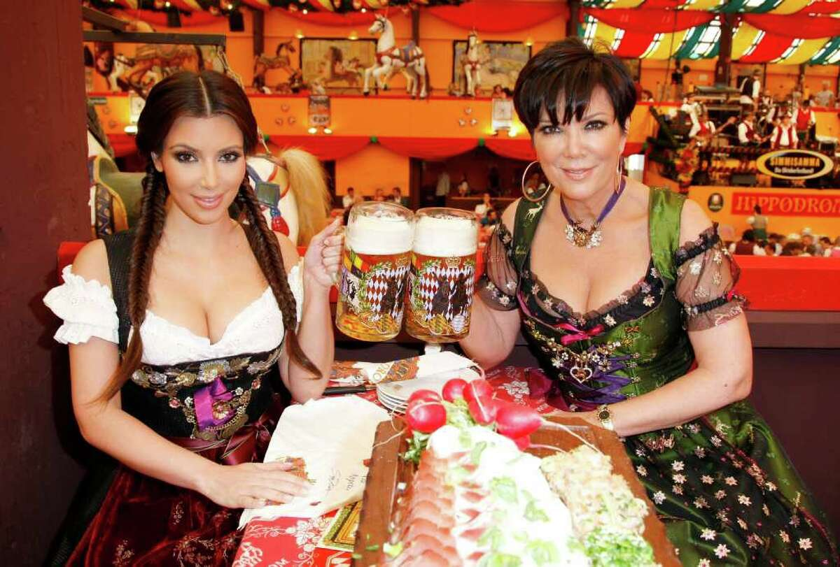 MUNICH, GERMANY - SEPTEMBER 22: Kim Kardashian and mother Kris Kardashian (both Dirndl/Dress: Lola Paltinger, Lollipop & Alenrock) visit the Oktoberfest 2010 at Hippodrom at Theresienwiese during her Munich Visit on September 22, 2010 in Munich, Germany. (Photo by Florian Seefried/Getty Images) *** Local Caption *** Kim Kardashian;Kris Kardashian