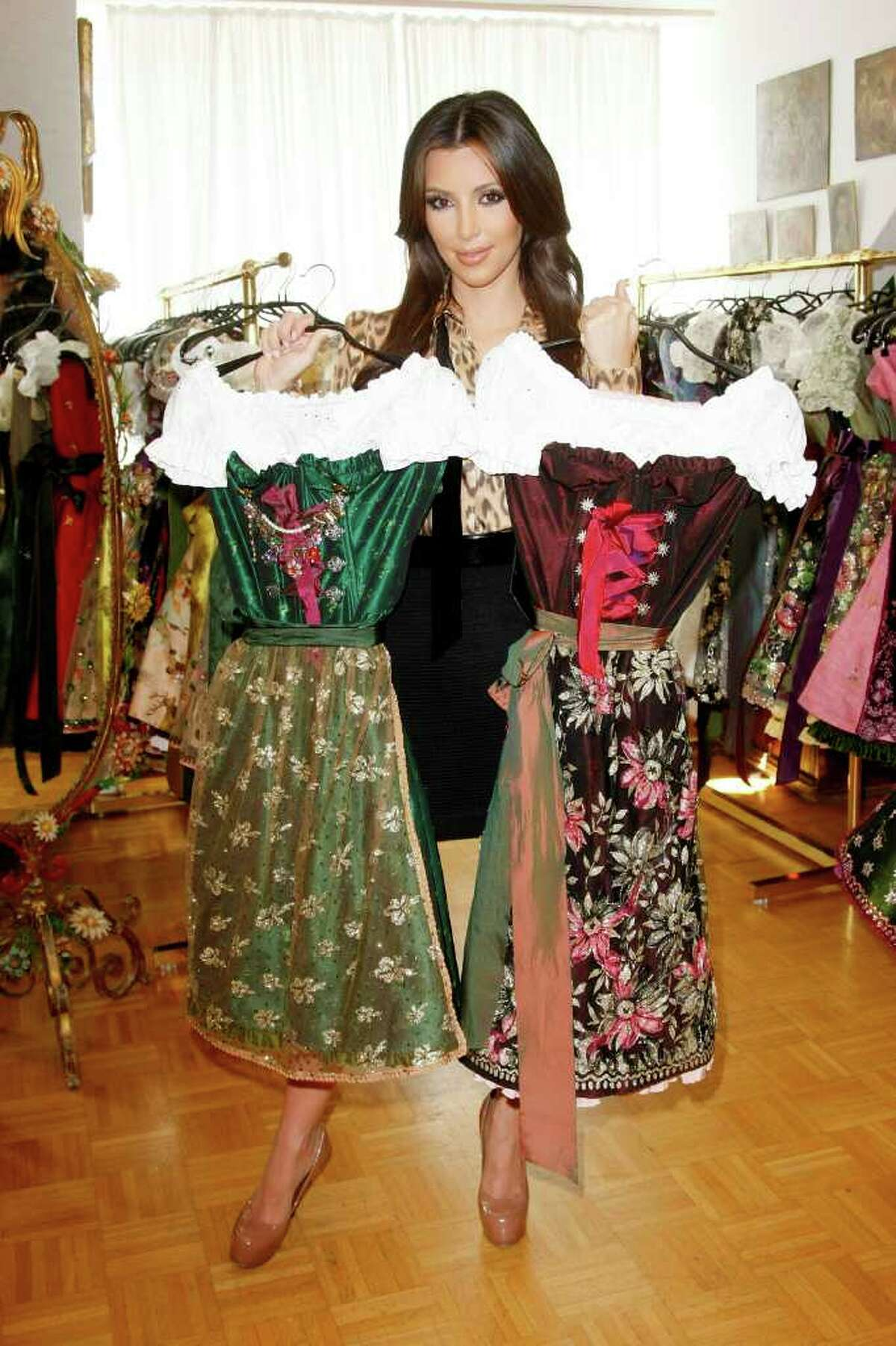 MUNICH, GERMANY - SEPTEMBER 22: Kim Kardashian attends the dirndl/dress fitting for her visit of the Oktoberfest 2010 at Lola Paltinger, Lollipop & Alpenrock store during her Munich Visit on September 22, 2010 in Munich, Germany. (Photo by Florian Seefried/Getty Images) *** Local Caption *** Kim Kardashian