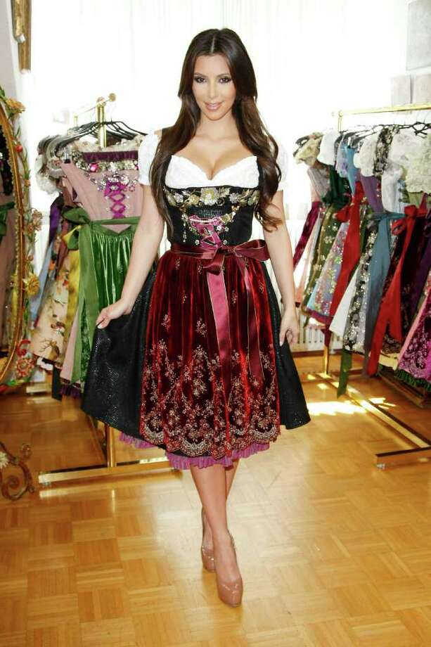 MUNICH, GERMANY - SEPTEMBER 22:  Kim Kardashian attends the dirndl/dress fitting for her visit of the Oktoberfest 2010 at Lola Paltinger, Lollipop & Alpenrock store during her Munich Visit on September 22, 2010 in Munich, Germany.  (Photo by Florian Seefried/Getty Images) *** Local Caption *** Kim Kardashian Photo: Florian Seefried, Getty Images / 2010 Getty Images