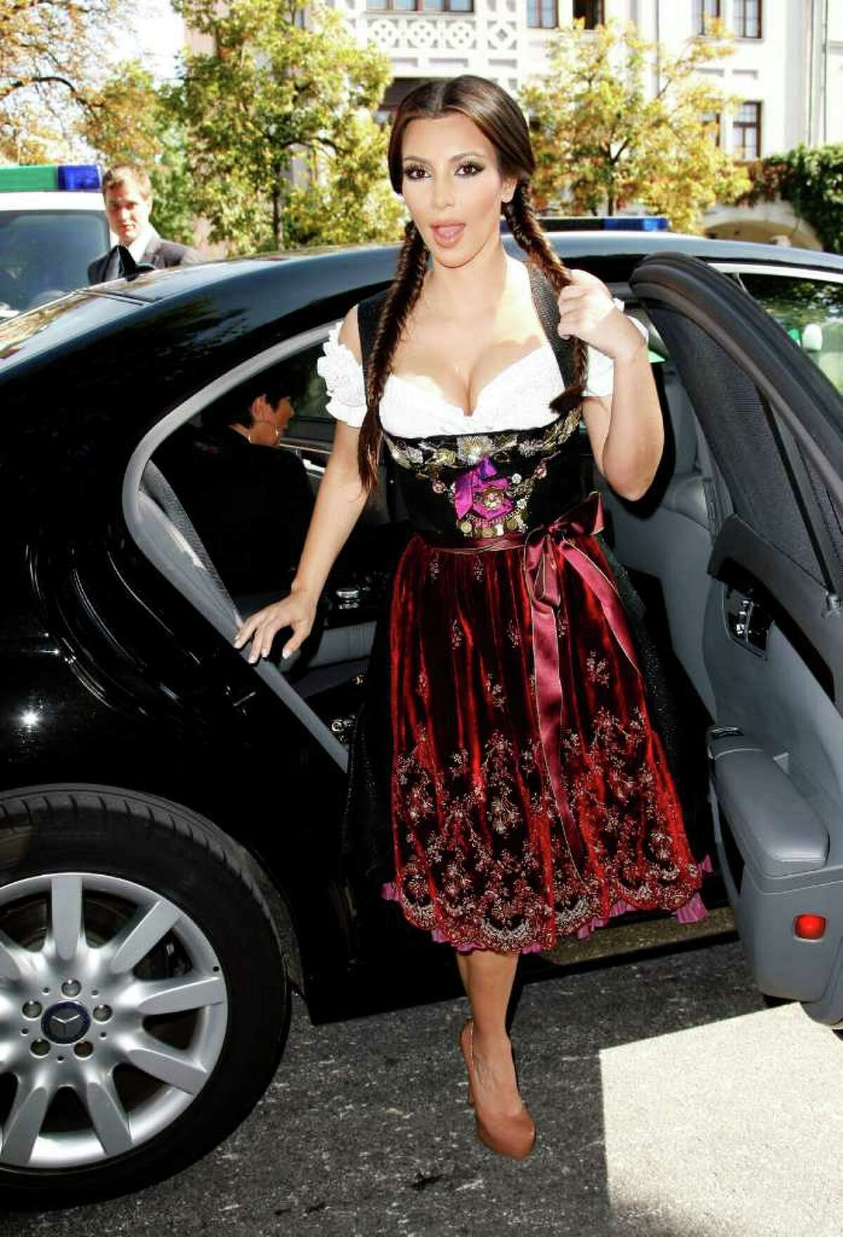 MUNICH, GERMANY - SEPTEMBER 22: Kim Kardashian (Dirndl/Dress: Lola Paltinger, Lollipop & Alpenrock) arrives for her visit of the Oktoberfest 2010 at Theresienwiese on September 22, 2010 in Munich, Germany. (Photo by Florian Seefried/Getty Images) *** Local Caption *** Kim Kardashian