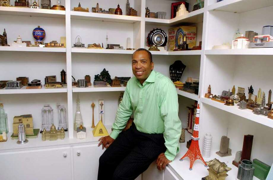 Darron Copeland is an employee of GE Capital who loves to collect miniatures. He is pictured on Thursday September 23, 2010 in a room he designed in his Stamford, Conn. to hold some of his miniature buildings. Photo: Dru Nadler / Stamford Advocate Freelance