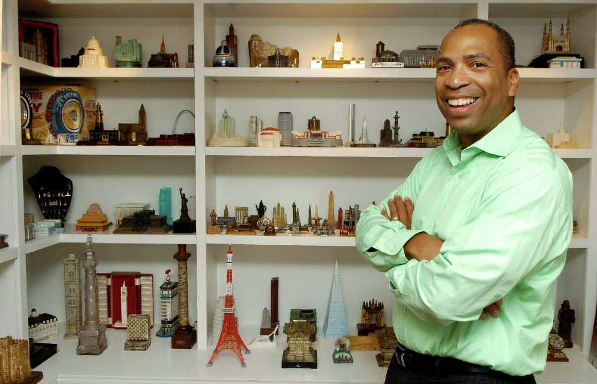 Darron Copeland is an employee of GE Capital who loves to collect miniatures. He is pictured in a room he designed to hold some of his miniature buildings in his Stamford, Conn. home on Thursday September 23, 2010.