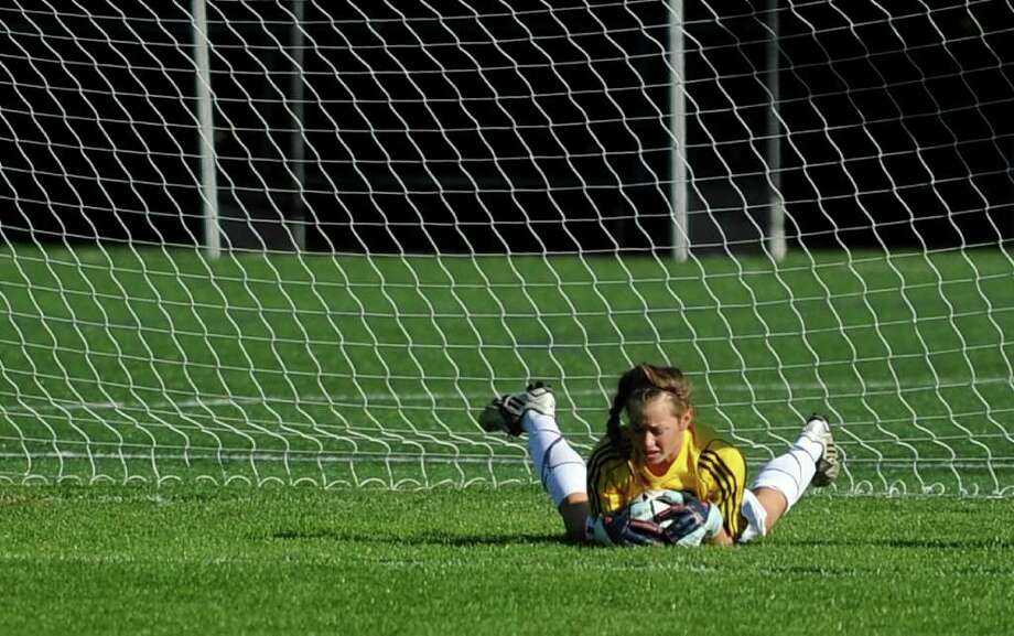 Staples' Jesse Ambrose makes a save during Tuesday's game against Brien McMahon High School at Staples High School in Fairfield September 21, 2010. Photo: Lindsay Niegelberg / Connecticut Post
