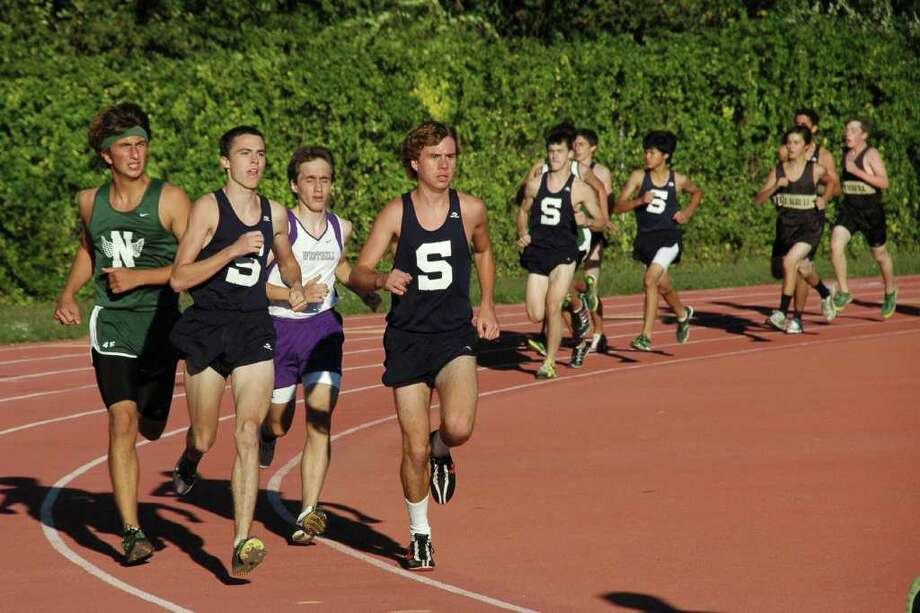 Staples senior captains Ben Aldrich (right) and Jack Roche (left) finish first and second, respectively in leading the Wreckers to a quad-meet sweep on Tuesday. Photo: Contributed Photo / Staplesrunning.com
