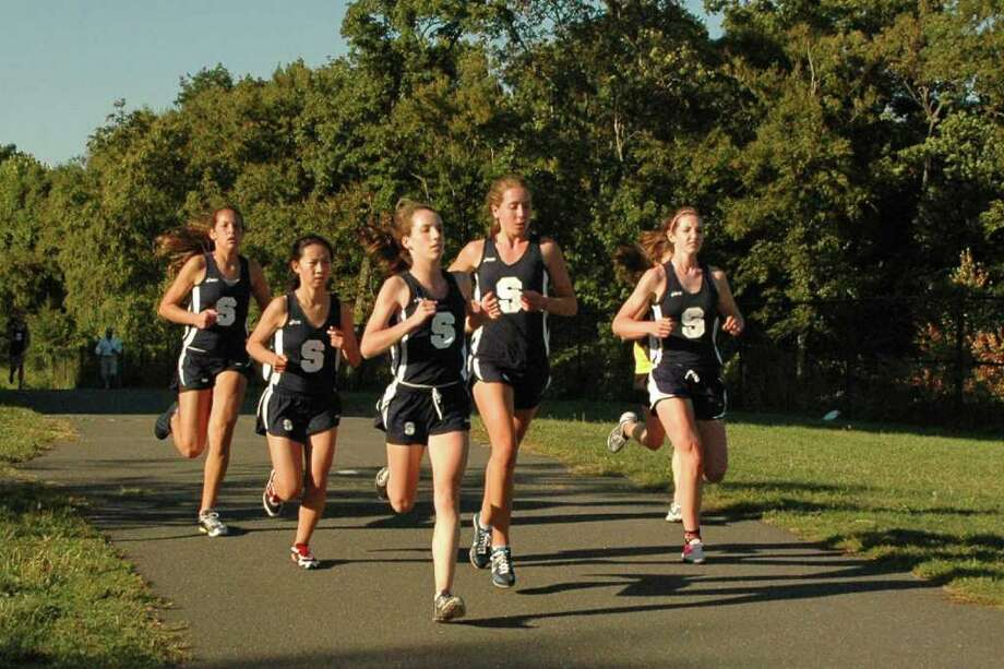 From left, Staples junior Alex Popkin, sophomore Judy Feng, senior  captain Emily Hanrahan, senior Ingrid Johnson and junior Caroline Smith run as a strong pack in leading the Lady Wreckers to a 2-1 record in Tuesday's quad-meet at home. Photo: Contributed Photo / Staplesrunning.com