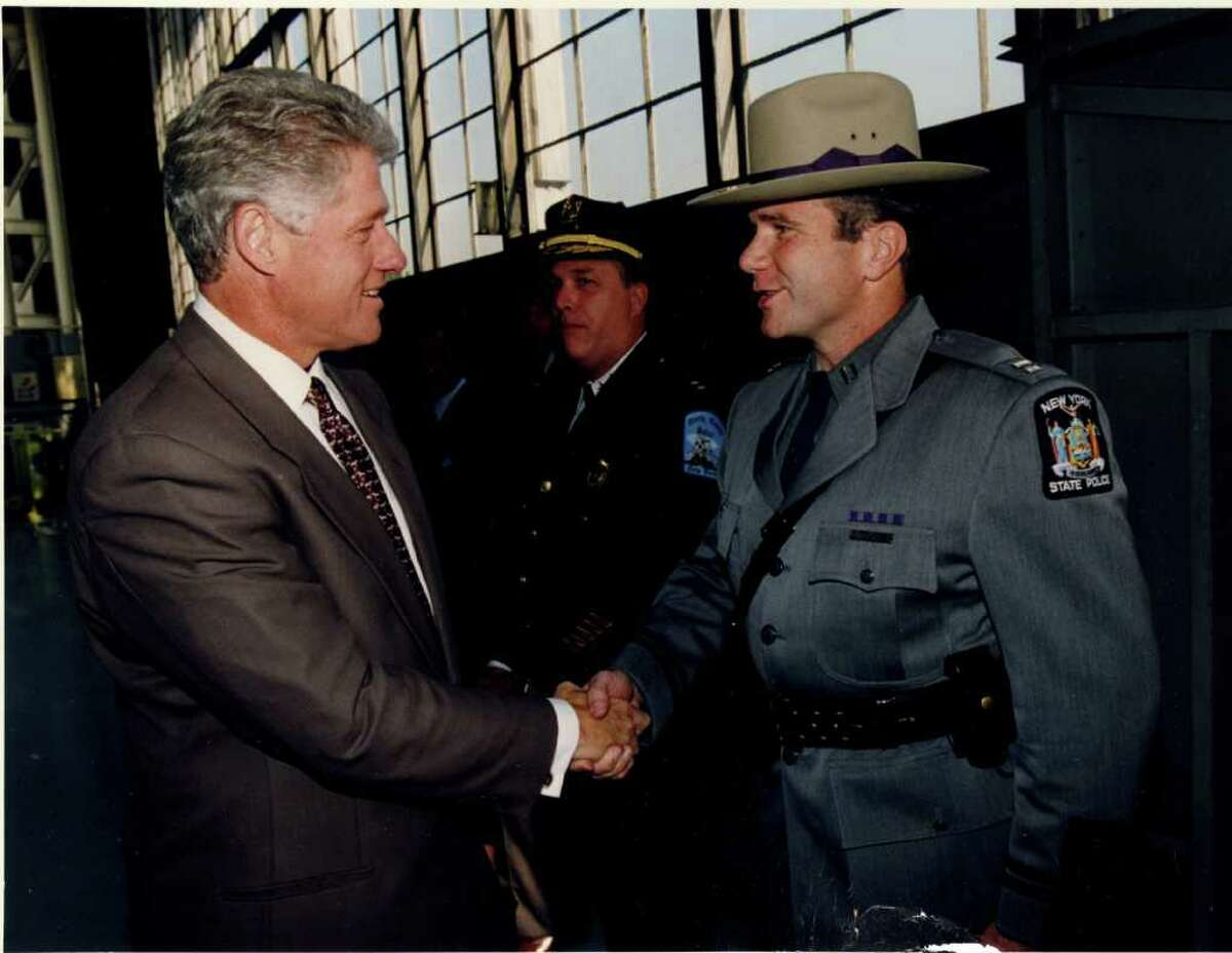 State Police Captain Ron Tritto meets President Bill Clinton in 1996 in Rockland County.
