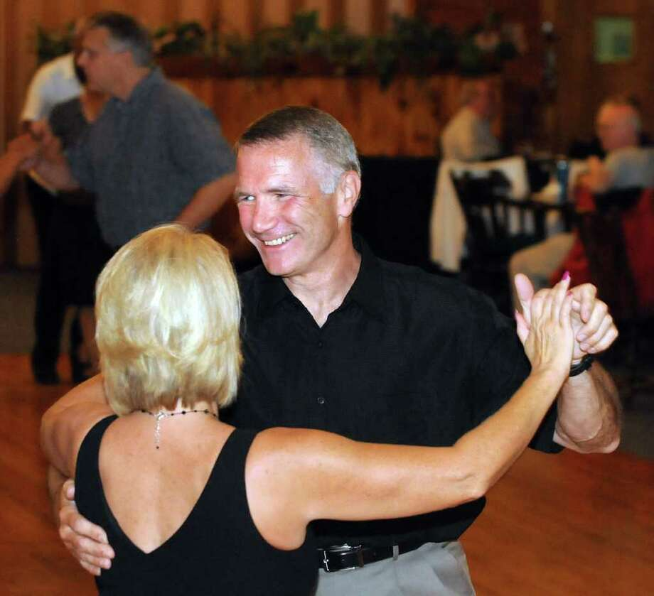 Ballroom dance instructor Ron Tritto, right, dances with instructor Karen Mason on Friday, Sept. 10, 2010, at EverGreen Country Club in Schodack, N.Y.  (Cindy Schultz / Times Union) Photo: Cindy Schultz / 00010206A