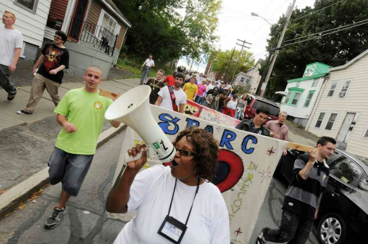 Led by St. Peter's Addiction Recovery Center program coordinator Joyce Love, marchers make their way down Elizabeth Street in Albany during the 20th annual Treatment Works march on Thursday. (Michael P. Farrell / Times Union)