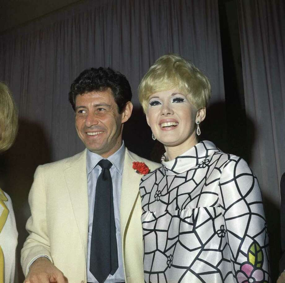 FILE - Eddie Fisher with Connie Stevens, his fiancée, are shown at the Fontainebleau Hotel in Miami Beach,in this Feb. 5, 1967 file photo. Fisher, whose huge fame as a pop singer was overshadowed by scandals ending his marriages to Debbie Reynolds and Elizabeth Taylor, died Wednesday night Sept. 22, 2010 of complications from hip surgery at a hospital in Berkeley. He was 85. (AP Photo, File) Photo: AP