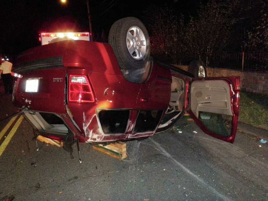 This Jeep Grand Cherokee flipped over early Friday on South Compo Road in Westport, after striking another Jeep parked on the side of the road. The driver was hospitalizd with non-life-threatening injuries. Photo: Contributed Photo / Westport News