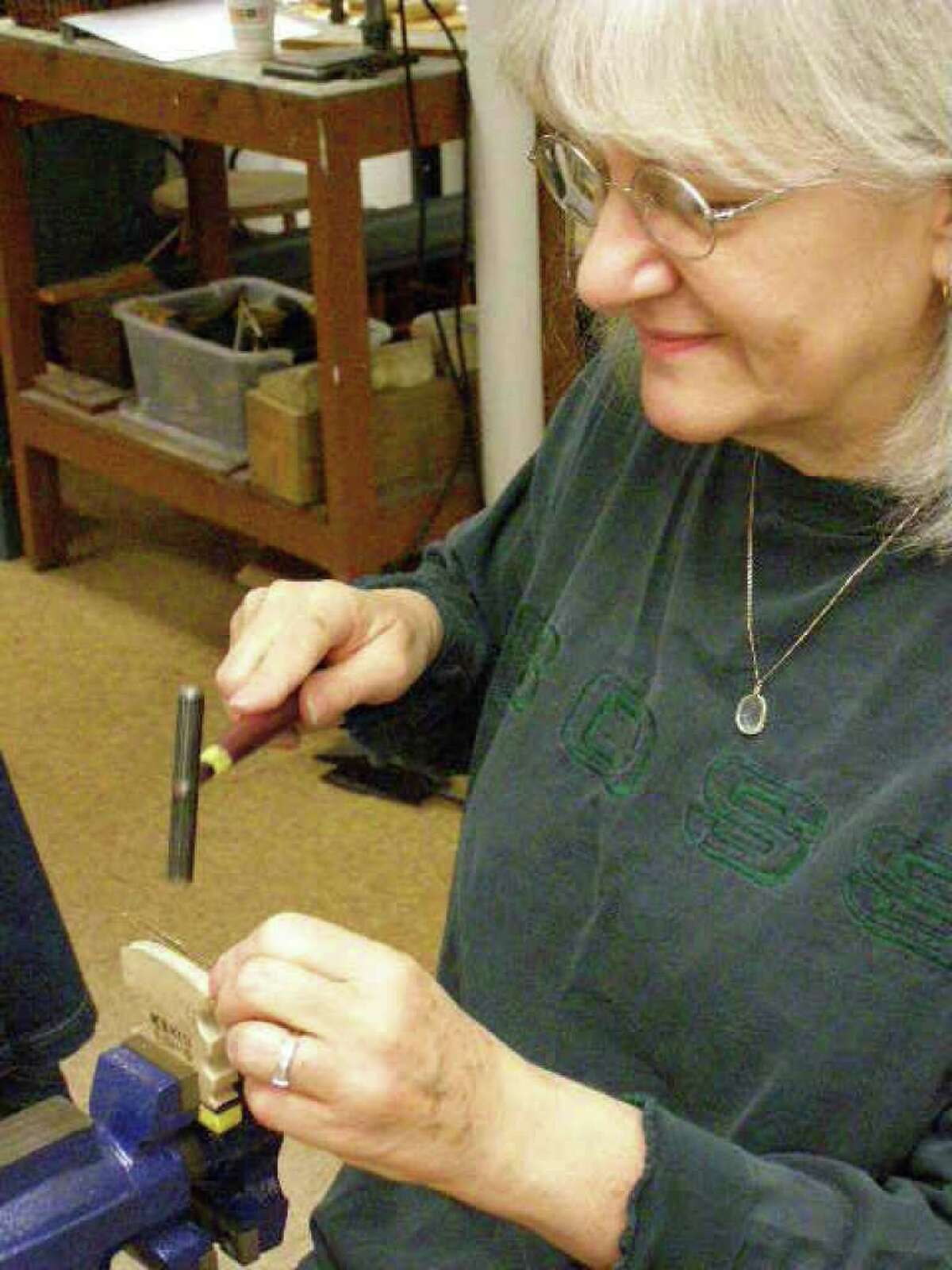 Pati Segar of Danbury works on a micro spiculum at The Brookfield Craft Center which began offering classes again last weekend after it closed in May. Sept. 2010 photo