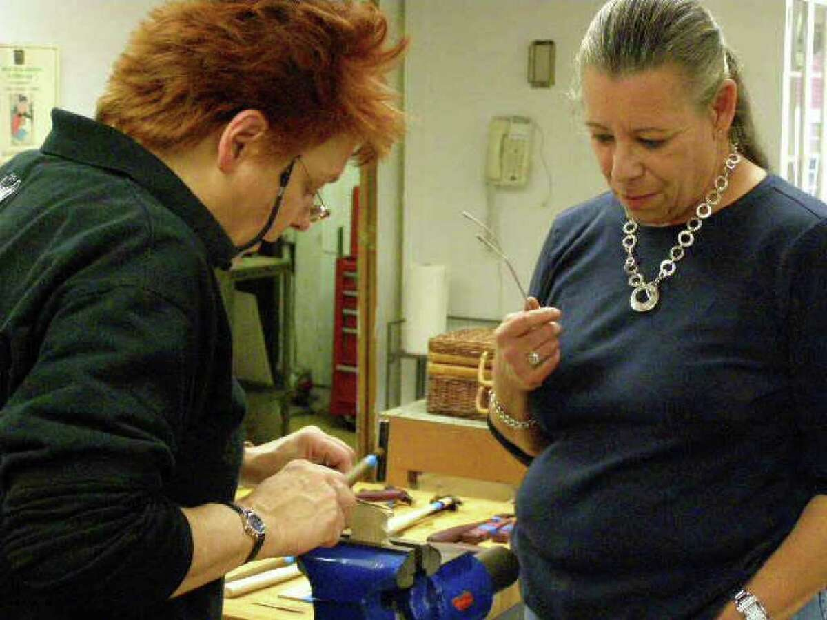 Instructor Andréa Kennington, left, demonstrates how to form a micro spiculum out of bronze to Bridgette Rallo at the Brookfield Craft Center which began offering classes again last weekend after it closed in May. Photo taken Sept. 2010.