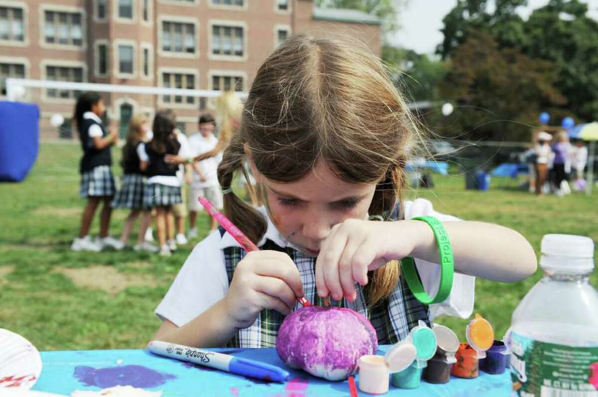 Sydney Gigliotti, 5 of Stamford, paints a small pumpking at the 2nd Annual Stanwich Family Festival at the Stamford campus in Stamford, Conn. on Friday September 24, 2010