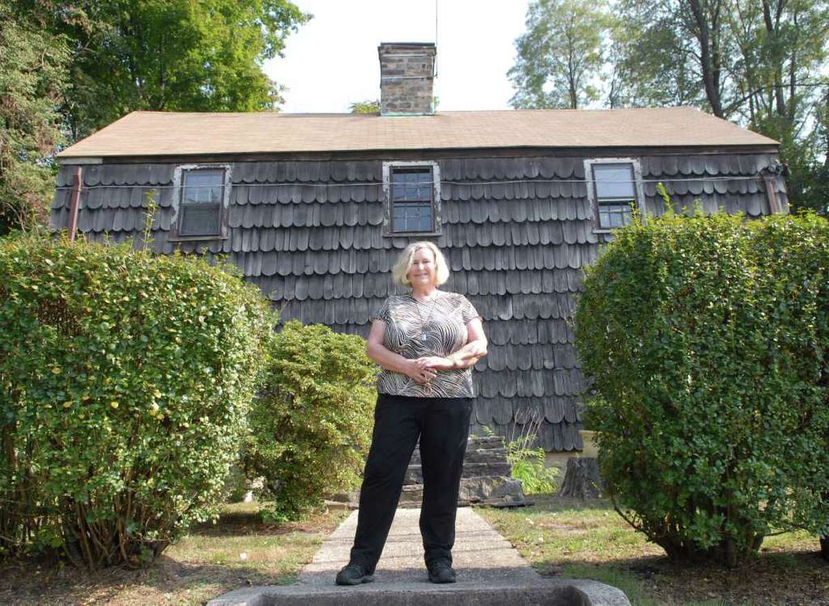 Ona Rae Ransom of Ramona, Calif., a descendant of the Lyon family, posed in front of the Thomas Lyon House on West Putnam Avenue and Byram Road, Friday afternoon, Sept. 24, 2010. Ransom was given a tour of the house by the Greenwich Preservation Trust.