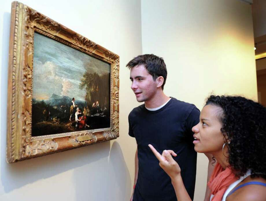 Fairfield University senior Sean Savage and junior Cicily Collazo examine a painting hung in the Frank and Clara Meditz Gallery Friday Sept. 24, 2010 at the new Bellarmine Museum of Art, set to open in October. Photo: Autumn Driscoll / Connecticut Post