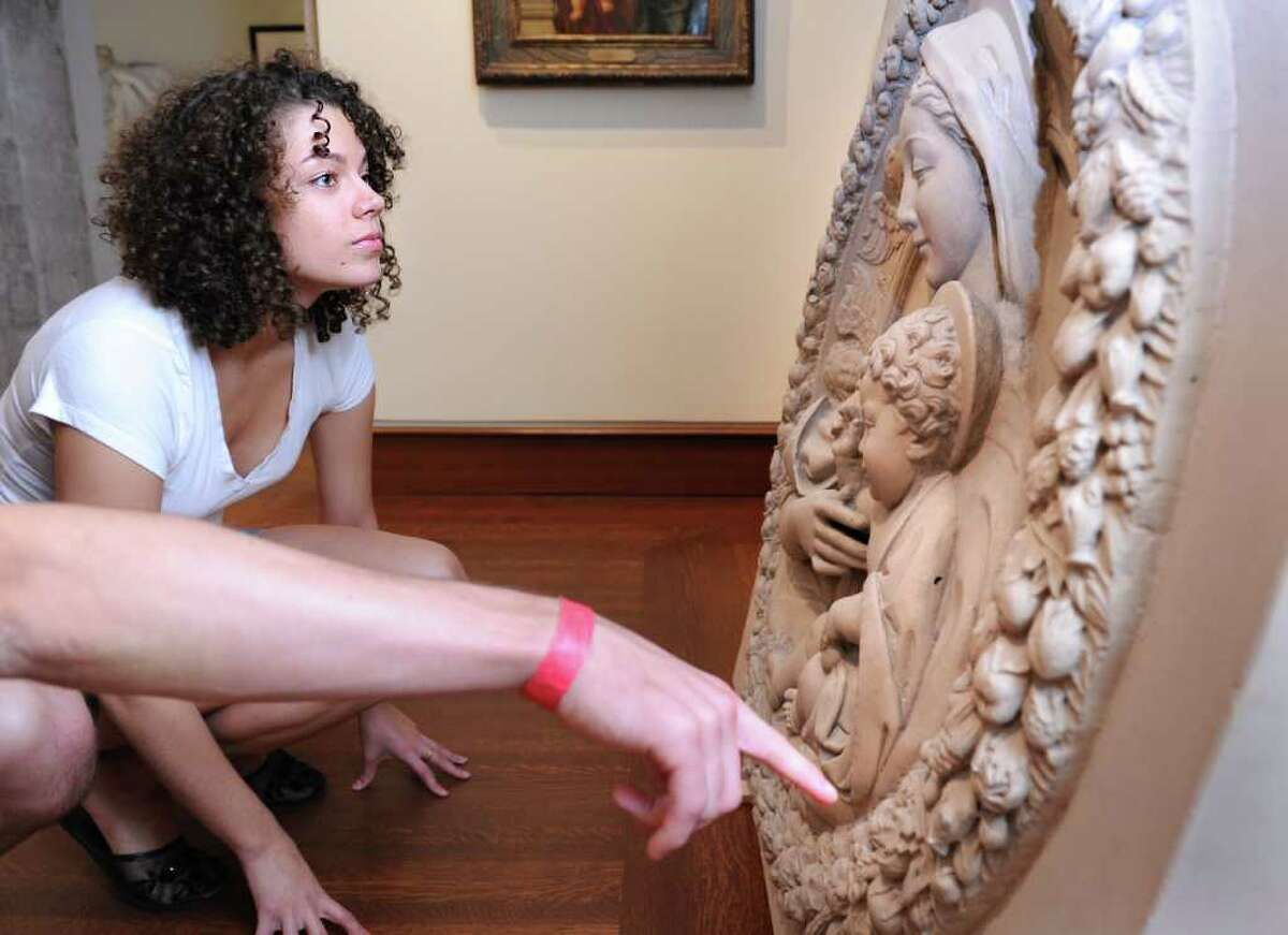 Fairfield University junior Amber Nowak takes a closer look at one of the pieces waiting to be hung in the Frank and Clara Meditz Gallery Friday Sept. 24, 2010 at the new Bellarmine Museum of Art, set to open in October.