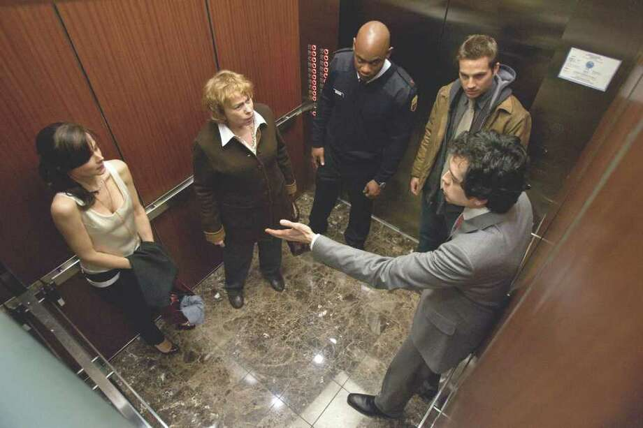 "(L to R) BOJANA NOVAKOVIC, JENNY O'HARA, BOKEEM WOODBINE, LOGAN MARSHALL-GREEN and GEOFFREY AREND in Universal Pictures' supernatural thriller with M. Night Shyamalan's signature touch, ""Devil"".  In the film, a group of people is trapped in the elevator, and one of them is the devil. (Kerry Hayes / Universal Pictures) Photo: Photo Credit: Kerry Hayes / Universal Pictures"