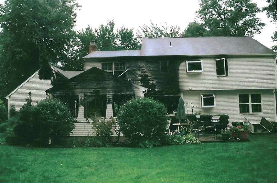 This July 2007 police photo released Friday, Sept. 24, 2010 by the Connecticut Judicial Branch as evidence in the Steven Hayes trial in New Haven, Conn., Superior Court, shows a rear view of the Petit's partially burned Cheshire, Conn., home where three family members were killed during a home invasion July 23, 2007.  (AP Photo/Connecticut Judicial Branch) Photo: Contributed Photo\Connecticut Judicial Branch / Connecticut Post Contributed\Connecticut Judicial Branch