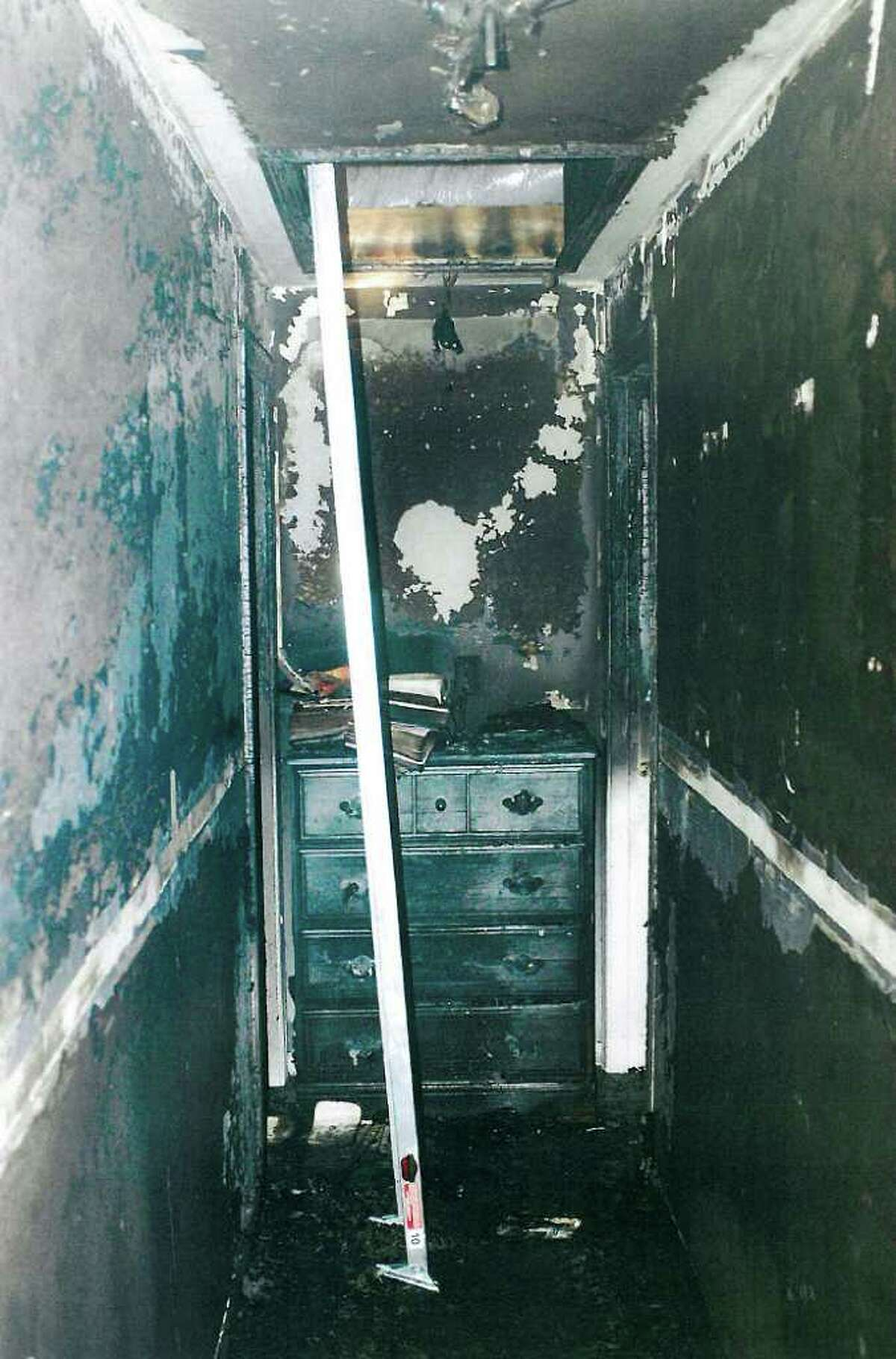 This July 2007 police photo released Friday, Sept. 24, 2010 by the Connecticut Judicial Branch as evidence in the Steven Hayes trial in New Haven, Conn., Superior Court, shows a charred upstairs hallway of the Petit's Cheshire, Conn., home, where three family members were killed during a home invasion July 23, 2007. (AP Photo/Connecticut Judicial Branch)