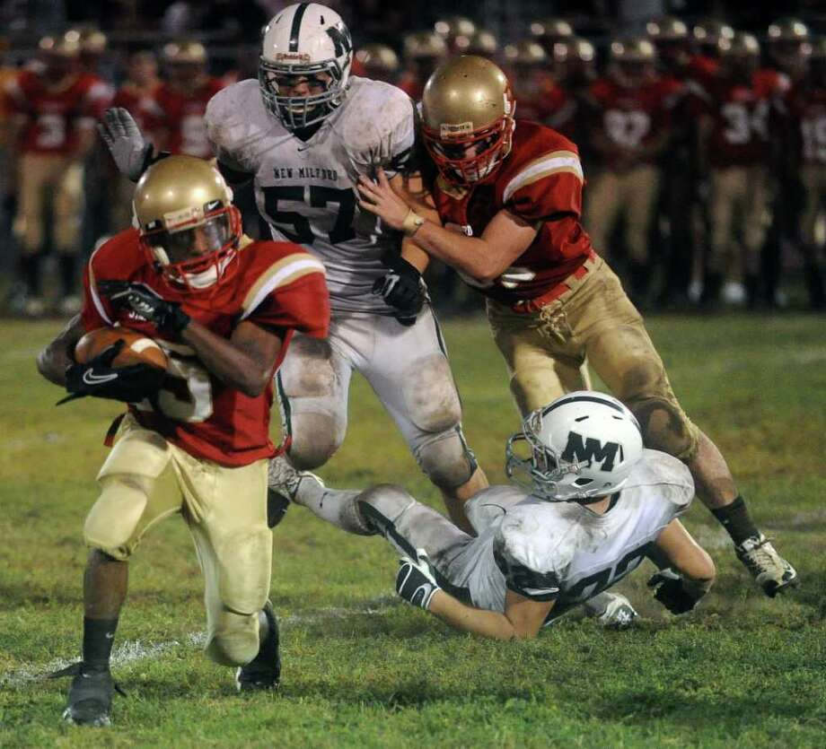 Stratford High School's Kevin Murat carries the ball during Friday's game against New Milford on September 24, 2010. Photo: Lindsay Niegelberg / Connecticut Post