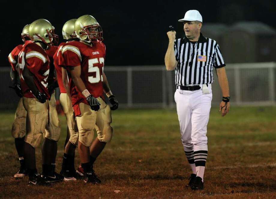 Greg Sperling calls a facemask foul as he officiates as head referee at the football game between Stratford High School and New Milford High School on Friday, September 24, 2010. Photo: Lindsay Niegelberg / Connecticut Post