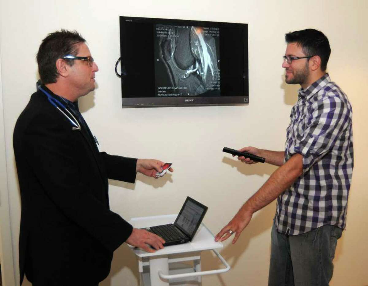 Dr. Mike Gerstenfeld,leftt, of the imedcenter.com of Danbury,and chief technology officer, Matt Meier, right, look at an MRI of a patients knee, on Friday, September 24, 2010.