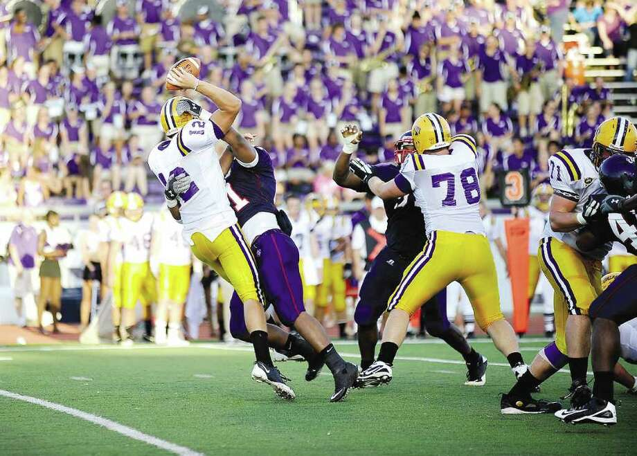 SFA's Malcolm Mattox makes a sack against Albany's quarterback in the first half of Saturday evening's game. (Andrew Rogers / Nagadoches Daily Sentinel) Photo: Staff Photo By Andrew Rogers / Andrew Rogers/The Daily Sentinel