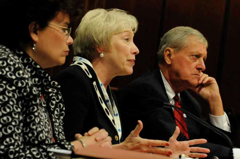 SUNY Chancellor Nany Zimpher, center, with SUNY Chairman Carl Hayden,right, and Senior Vice Chancellor Monica Rimai answer questions during a New York State Senate hearing into excessive pay raises for SUNY officials at the Capitol in Albany Friday afternoon. 9/24/2010. (Michael P. Farrell / Times Union) Photo: Michael P. Farrell
