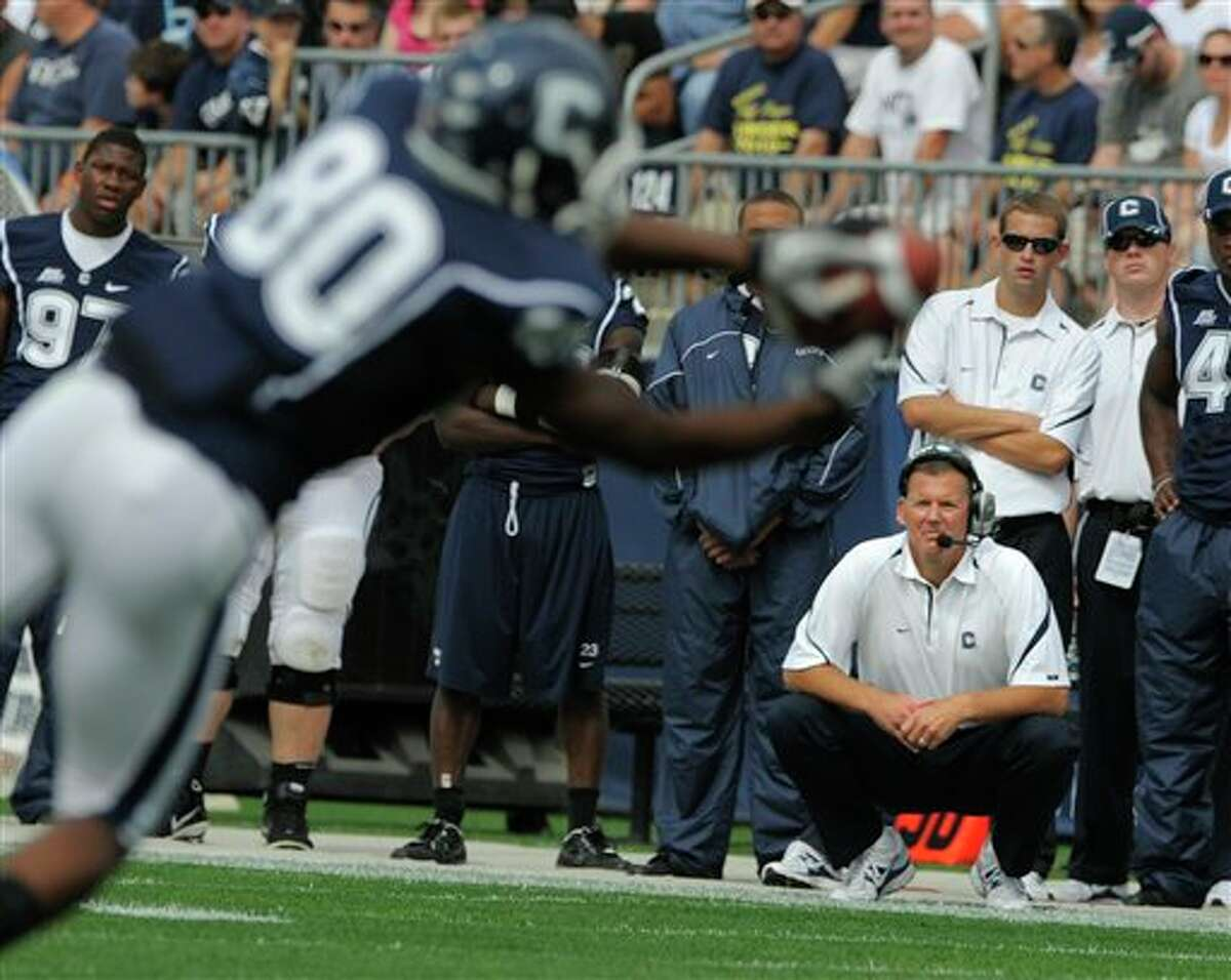 Connecticut  head coach Randy Edsall, lower right, watches wide receiver Michael Smith during the first half of Connecticut's 45-21 victory in their NCAA football game in East Hartford, Conn., on Saturday, Sept. 25, 2010.