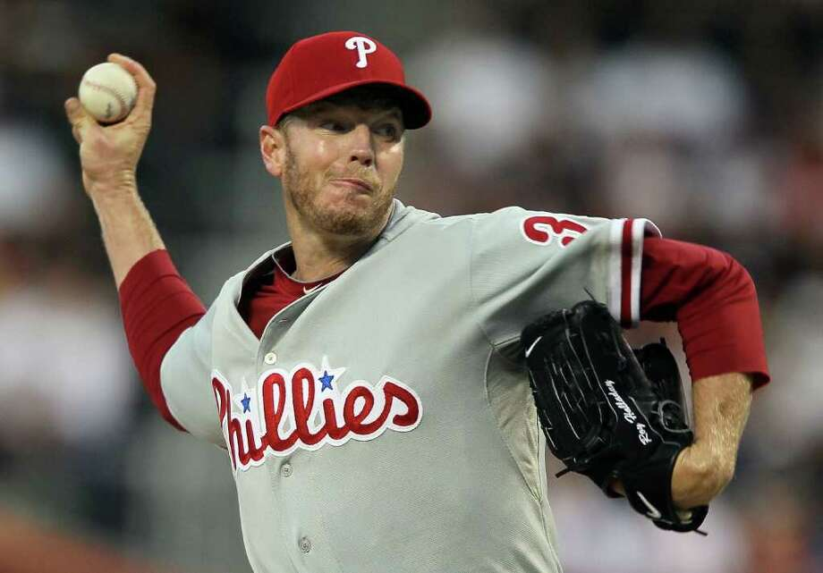 NEW YORK - AUGUST 14:  Roy Halladay #34 of the Philadelphia Phillies delivers a pitch against the New York Mets on August 14, 2010 at Citi Field in the Flushing neighborhood of the Queens borough of New York City.  (Photo by Jim McIsaac/Getty Images) *** Local Caption *** Roy Halladay Photo: Jim McIsaac, Getty Images / 2010 Getty Images