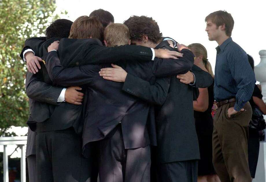 Classmates of Cameron Bruce gather around to console each other outside before the start of a memorial service for Bruce at the Saugatuck Congregational Church in Westport on Saturday September 25, 2010. Bruce, graduated from Staples in 2010 and was in his first week at Queensland University in Kingston, Ontario, Canada, when he died after falling out of a dorm window. Photo: Christian Abraham / Connecticut Post